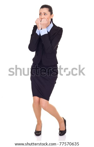 afraid businesswoman, biting her nails, isolated on white