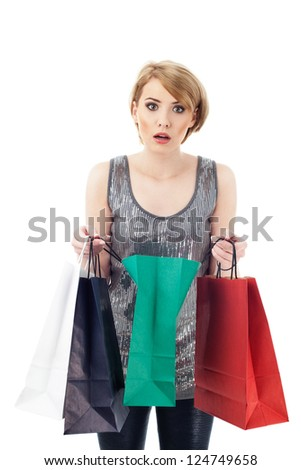 Afraid woman with shopping bags. Isolated on white background.