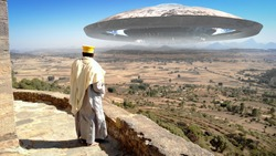 Afriacn Priest Lookin at Large Alien Ufo saucer Ship over the mountains Large ufo saucer flying over mountains in Africa with priest watching
