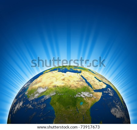 Africa and the Middle east view on an Earth planet globe model with a bright radial blue background.