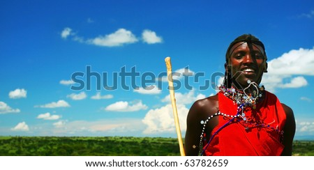 AFRICA,KENYA,MASAI MARA-NOVEMBER 12:Masai warriors dancing traditional jumps as cultural ceremony,review of daily life of local people,near Masai Mara National Park Reserve,November 12,2008 in Kenya