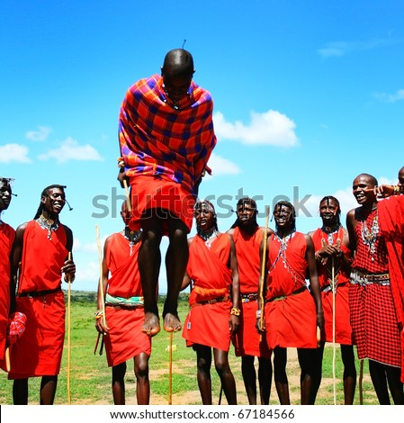 AFRICA,KENYA,MASAI MARA - NOVEMBER 12:Masai warriors dancing traditional jumps as cultural ceremony,review of daily life of local people,near to Masai Mara National Park Reserve,November 12,2008,Kenya
