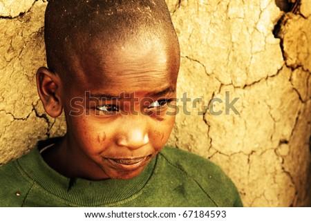 AFRICA,KENYA,MASAI MARA - NOVEMBER 12:portrait on an African Kid of Masai village smiling to camera,review of daily life of local people,near to Masai Mara National Park Reserve,November 12,2008,Kenya
