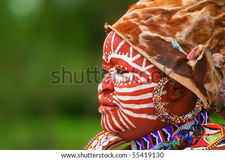 AFRICA, KENYA,NAKURU, NOVEMBER 9: Portrait of a Kenyan warrior with traditionally painted face, review of daily life of local people, near to Lake Nakuru National Park Reserve, November 9, 2008, Kenya