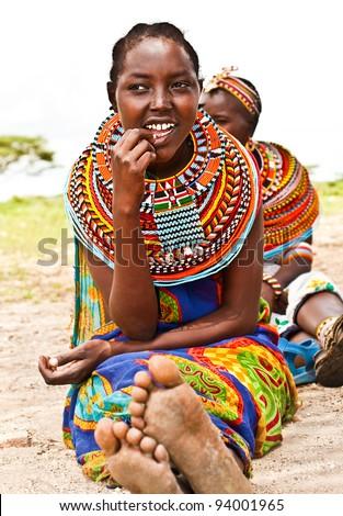AFRICA,KENYA, SAMBURU - NOVEMBER 8: Portrait of Samburu  woman wearing traditional handmade accessories, review of daily life of local people, near Samburu Park National Reserve, November 8, 2008, Kenya