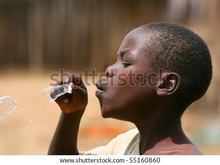AFRICA,KENYA,SUMBURU,NOVEMBER 8: portrait of an African Kid of Sumburu tribe village posing to camera, review of daily life of local people, near Sumburu Park National Reserve, November 8, 2008, Kenya
