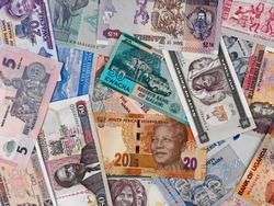 Africa money, heap of various african banknotes, currency background