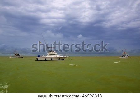 Africa Saly Senegal green ocean cloudy storm sky and boats