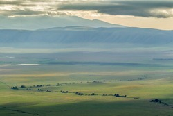 Africa, Tanzania, Ngorongoro Crater. Cloudy landscape inside crater.