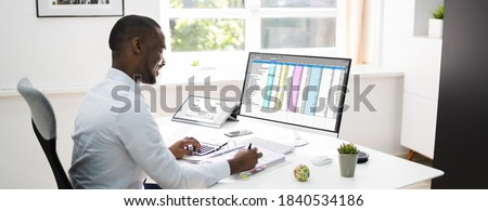African American Accountant Using Electronic Invoice Software Сток-фото ©