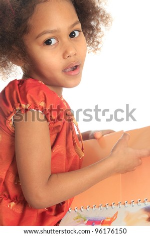 African American Asian black child reads a book isolated metisse