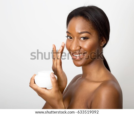african american beauty using face cream