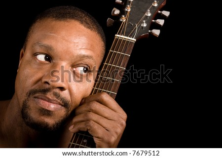 african american blues singer with guitar, looking into empty copy space