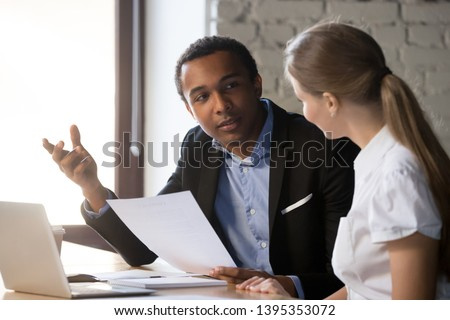 African american boss negotiating discussing contract details with company corporate woman client. Black hr manager interviewing young female job candidate. Employment hiring human resources concept
