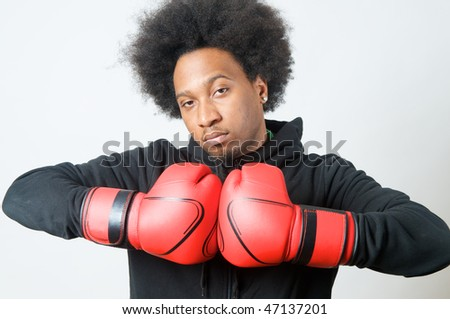 African American Boxer with red boxing gloves