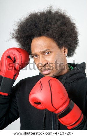 African American Boxer with red boxing gloves with aggression
