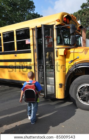 African American Boy Boarding School Bus Open Doors Early Morning Shadows of People on the Ground