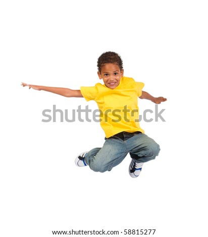 african american boy jumping over white background