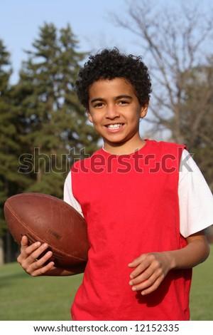 African American boy playing a football
