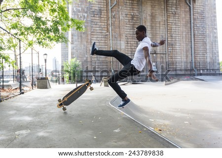 African american Boy Skating at Park and Falling Down