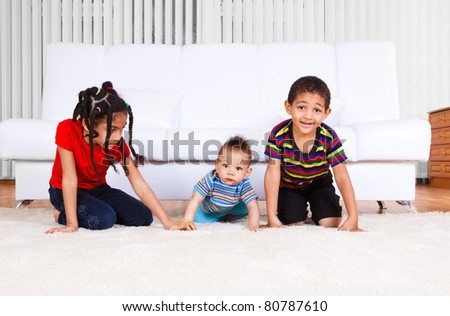 African american brothers and a sister crawling