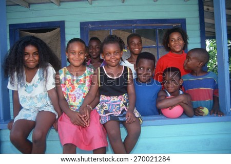 African-American brothers and sisters on their front porch