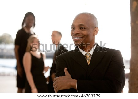 African American business man in front of business team
