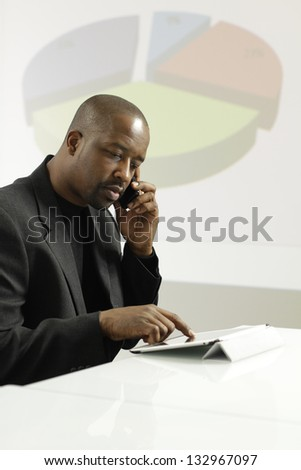 African American business man on his phone