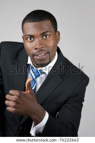 African American business man showing thumb up.