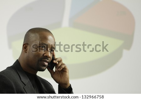 African American business man taking a business call
