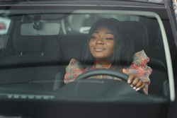 african american business woman driving.