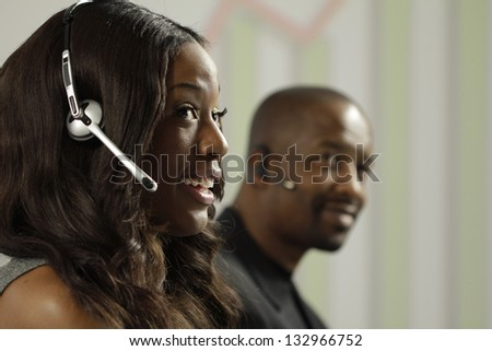African American business woman taking a sales call using a headset