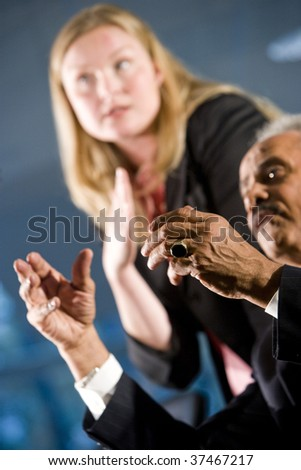 African American businessman and female assistant in a boardroom meeting