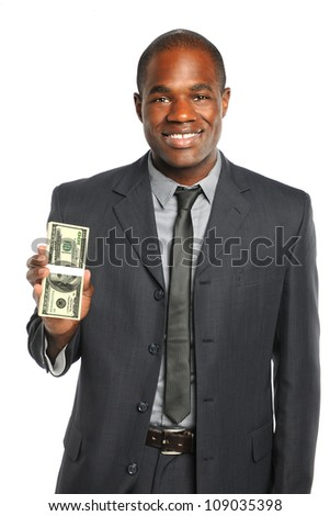 African American businessman holding stack of one hundred dollar bills isolated over white background - stock photo