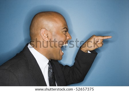 African American businessman screaming and pointing.