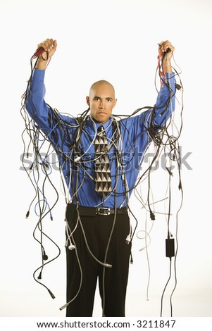African American businessman wrapped in computer cables.