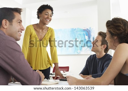 African American businesswoman having discussion with colleagues in office