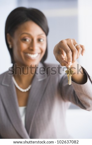 African American businesswoman holding key