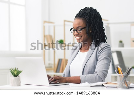 African American Businesswoman Using Laptop In Modern Office. Copy Space