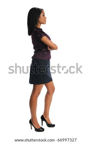 African American businesswoman with arms crossed standing over white background
