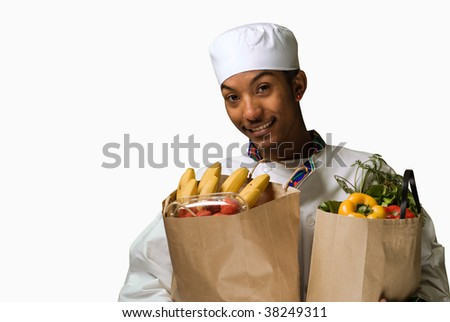 African American Chef with Groceries isolated on white