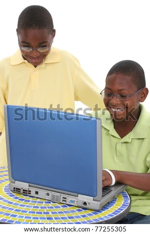 African American Children Playing On Laptop Computer