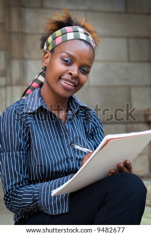 African American college student or office secretary PA taking notes