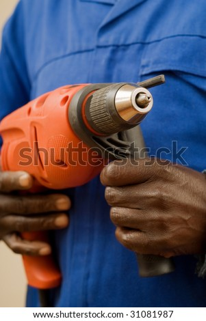 African American Construction Worker Holding Power Tool in Hands