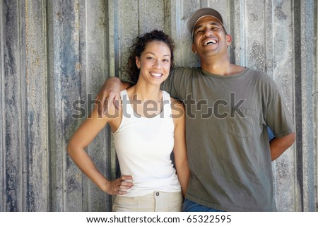 African American couple hugging and smiling