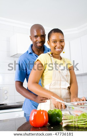stock photo : african american couple hugging in kitchen