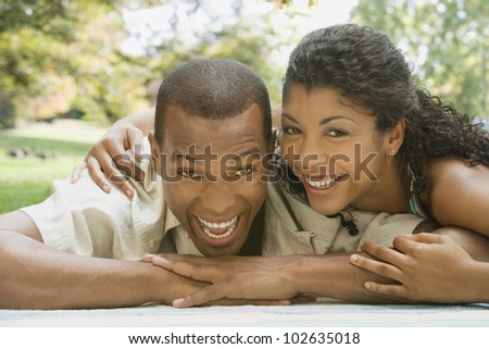African American couple laying on blanket