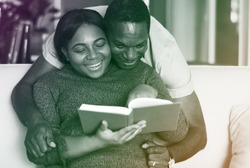 African American Couple Read Book Together