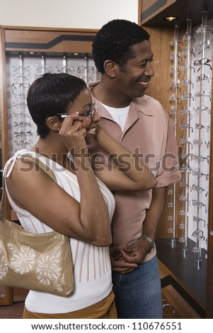 African American couple selecting eyeglasses at spectacles shop