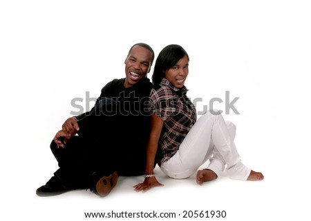 African American Couple Sitting on White Background Laughing Together